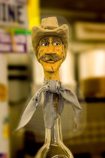 Figure of cowboy at a bottle stopper displayed at Fredericksburg winery, Fredericksburg, Texas