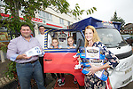 Mrs Cavelle Fabrizi and her husband Gaetano and their two daughters, Isabella and Jessica collecting her prize of a years supply of Braces Bread from Carl Arataki a member of Braces Fun Team.<br /> 21.09.13<br /> <br /> &copy;Steve Pope-FOTOWALES