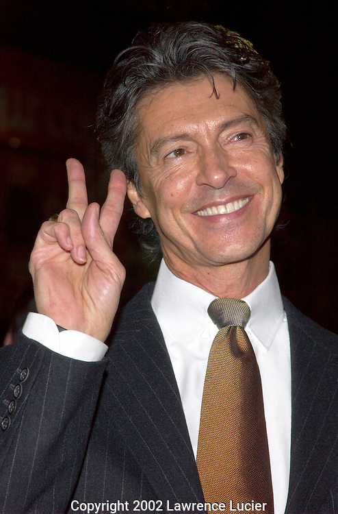 NEW YORK-OCTOBER 25: Director/choreographer Tommy Tune arrives at the opening night of the musical Moving Out October 25, 2002, at the Richard Rodgers Theater in New York City. The musical is based on 28 Billy Joel songs.