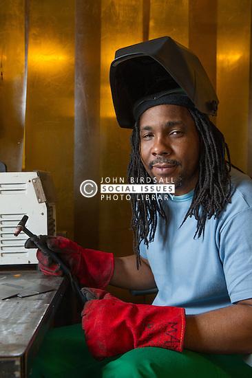 A prisoner working in a workshop
