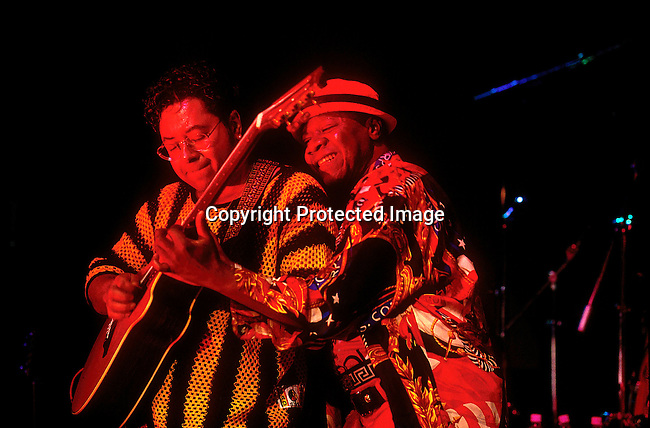 EVMUSIC06202.Events. Music. Johannesburg. Papa Wemba from Congo in colourful dress with man playing guitar on stage. 95..©Per-Anders Pettersson / iAfrika Photos
