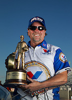 Sept. 2, 2013; Clermont, IN, USA: NHRA pro mod driver Mike Janis poses for a photo as he celebrates after winning the US Nationals at Lucas Oil Raceway. Mandatory Credit: Mark J. Rebilas-