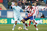 Atletico de Madrid's Jose Maria Gimenez (r) and Granada's Youssef El Arabi during La Liga match.January 18,2015. (ALTERPHOTOS/Acero)