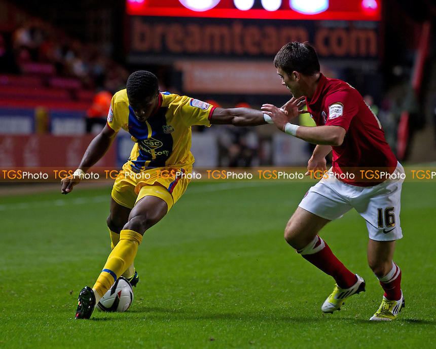 Wilfred Zaha, Crystal Palace FC holds off Rhoys Wiggins, Charlton Athletic FC - Charlton Athletic vs Crystal Palace - NPower Championship Football at The Valley, London - 14/09/12 - MANDATORY CREDIT: Ray Lawrence/TGSPHOTO - Self billing applies where appropriate - 0845 094 6026 - contact@tgsphoto.co.uk - NO UNPAID USE.
