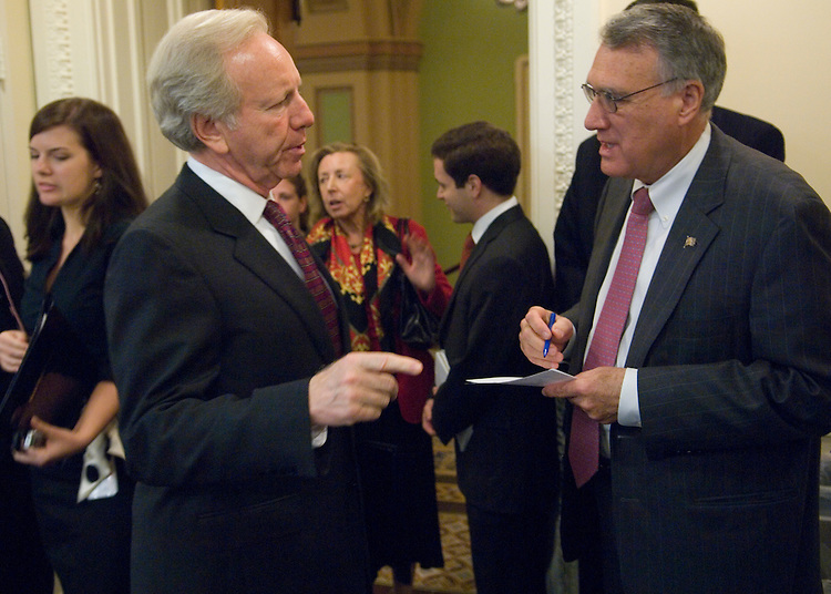 Sen. Jon Kyl, R-Ariz., and Sen. Joe Lieberman, I-Conn., talk before their news conference in support of the administration's new sanction against Iran on Thursday, Oct. 25, 2007. Hadassah Lieberman, in background, accompanied Sen. Lieberman to the event.