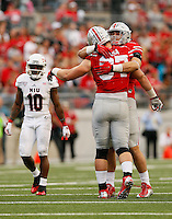 Ohio State Buckeyes defensive lineman Joey Bosa (97) hugs defensive end Sam Hubbard (6) after he sacked Northern Illinois Huskies quarterback Drew Hare (12) during the fourth quarter of the NCAA football game at Ohio Stadium in Columbus on Sept. 19, 2015. (Adam Cairns / The Columbus Dispatch)