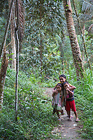 Bali, Indonesia.  Balinese Children on a Forest Path.