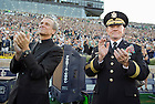 Sept. 6, 2014; University president Rev. John I. Jenkins, C.S.C. and Army Gen. Martin E. Dempsey, chairman of the Joint Chiefs of Staff watch the paratroopers land in Notre Dame Stadium prior to the Michigan game. (Photo by Barbara Johnston/ University of Notre Dame)