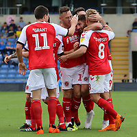 Fleetwood Town's Ched Evans is mobbed after scoring the opening goal<br /> <br /> Photographer David Shipman/CameraSport<br /> <br /> The EFL Sky Bet League One - Oxford United v Fleetwood Town - Saturday August 11th 2018 - Kassam Stadium - Oxford<br /> <br /> World Copyright &copy; 2018 CameraSport. All rights reserved. 43 Linden Ave. Countesthorpe. Leicester. England. LE8 5PG - Tel: +44 (0) 116 277 4147 - admin@camerasport.com - www.camerasport.com