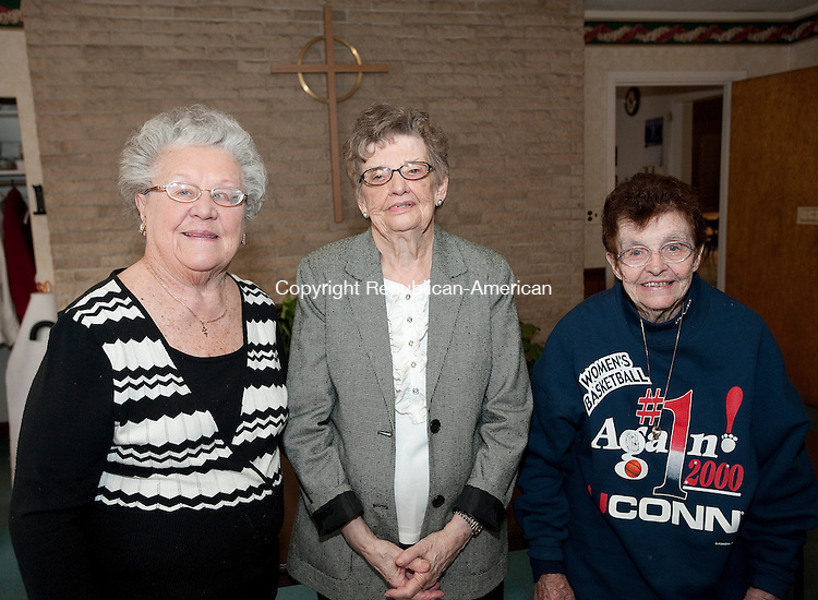 WATERBURY, CT-0403814JS08-Members Helen Bokon, Angie Judson and Denise Kennedy at the Waterbury Women's Club's 125th anniversary meeting at the First Congregational Church in Waterbury. <br />  Jim Shannon Republican-American
