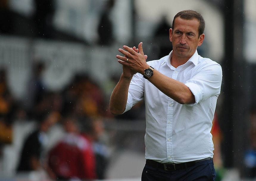 Newport County manager Justin Edinburgh applauds supporters at the final whistle<br /> <br /> Photographer Kevin Barnes/CameraSport<br /> <br /> Football - The Football League Sky Bet League Two - Newport County AFC v Wycombe Wanderers - Saturday 9th August 2014 - Rodney Parade - Newport<br /> <br /> &copy; CameraSport - 43 Linden Ave. Countesthorpe. Leicester. England. LE8 5PG - Tel: +44 (0) 116 277 4147 - admin@camerasport.com - www.camerasport.com