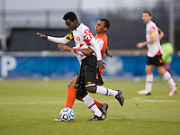 Mikias Eticha (11) of Maryland fights for the ball with Marcus Salady-Defour (16) of Virginia during the ACC Finals at the Maryland SoccerPlex in Boyds, MD.  Maryland defeated Virginia, 1-0, to win the title.