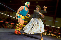 26 year old wrestler Yolanda La Amorosa (fighting name), Veraluz Cortez (real name) fights Craquen at the Multifuncional building in El Alto. Veraluz is a Cholita, a wrestler of native Aymara descent. When Cholitas fight they wear traditional costume. Veraluz fights with the lucha libre (free wrestling) group Los Diosas del Ring. ..