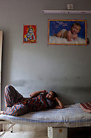 Women lounge around the surrogate house for their entire term of pregnancy while posters of babies and religious symbols adorn the walls together with calendars that they often use to count their days to the end of their terms. ..The Akanksha Infertility Clinic in Anand, Gujarat, India, is known internationally for its surrogacy program and currently has over a hundred surrogate mothers pregnant in their environmentally controlled surrogate houses.