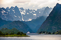 Norway, Lofoten. Raftsundet is a 20km long strait separating Austvågøya and Hinnøya. Hurtigruta entering Trollfjorden.