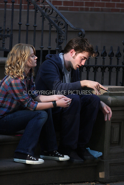 WWW.ACEPIXS.COM . . . . .  ....July 14 2009, New York City....Actors Emilie De Ravin and Robert Pattinson on the Brooklyn set of the new movie 'Remember Me' on July 14 2009 in New York City....Please byline: AJ Sokalner - ACEPIXS.COM..... *** ***..Ace Pictures, Inc:  ..tel: (212) 243 8787..e-mail: info@acepixs.com..web: http://www.acepixs.com