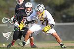 Palos Verdes, CA 03/30/10 - Sean Wilson (Peninsula #27) and Brooks Hawkins (Palos Verdes #22) in action during the Palos Verdes-Peninsula JV Boys Lacrosse game.