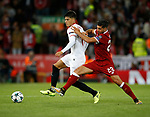 Joaquin Correa of Sevilla and Emre Can of Liverpool during the Champions League Group E match at the Anfield Stadium, Liverpool. Picture date 13th September 2017. Picture credit should read: Simon Bellis/Sportimage