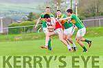 Daingean Uí Chúis Gavan Ó Currain in possession of the ball tackled by South Kerry Denis Daly, Paul Donoghue and Greg Gibson during the match at Pairc an Aghasaigh, Dingle, on Sunday afternoon.