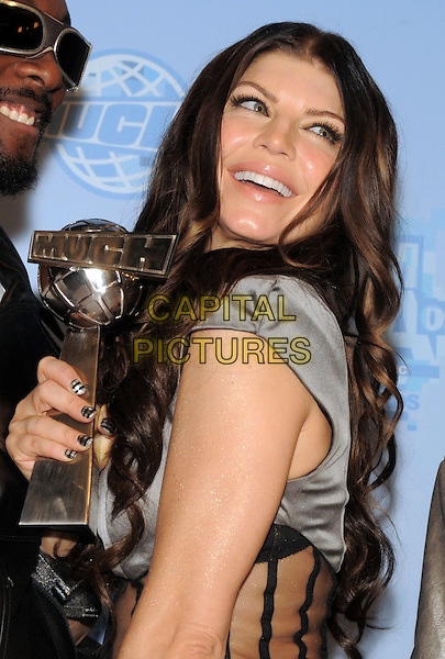 BLACK EYED PEAS -  Fergie.20th Annual MuchMusic Video Awards at the MuchMusic HQ, Toronto, Ontario, Canada..June 21st, 2009.half length black award trophy facial hair  silver sheer top silk satin stacey ferguson stacy.CAP/ADM/BPC.©Brent Perniac/AdMedia/Capital Pictures.