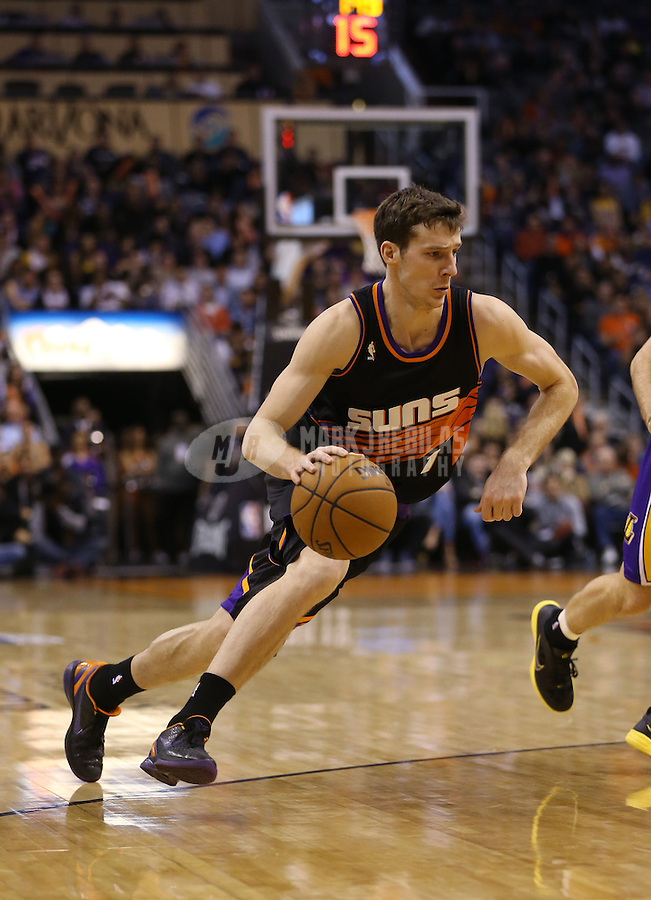 Jan. 30, 2013; Phoenix, AZ, USA: Phoenix Suns guard Goran Dragic (1) against the Los Angeles Lakers at the US Airways Center. Mandatory Credit: Mark J. Rebilas-