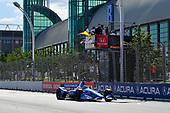 Sebastien Bourdais, Dale Coyne Racing with Vasser-Sullivan Honda crosses the finish line under the checkered flag
