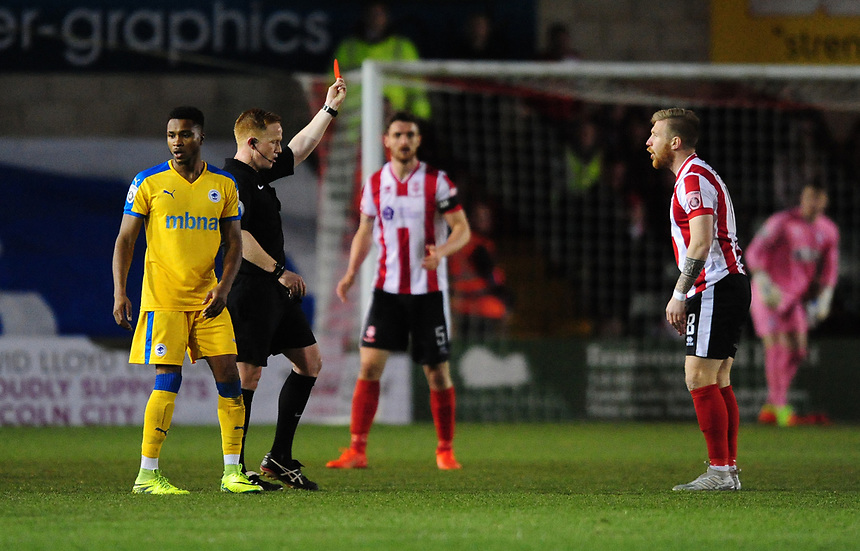 Lincoln City's Alan Power is shown a red card by referee Alan Young<br /> <br /> Photographer Chris Vaughan/CameraSport<br /> <br /> Vanarama National League - Lincoln City v Chester - Tuesday 11th April 2017 - Sincil Bank - Lincoln<br /> <br /> World Copyright &copy; 2017 CameraSport. All rights reserved. 43 Linden Ave. Countesthorpe. Leicester. England. LE8 5PG - Tel: +44 (0) 116 277 4147 - admin@camerasport.com - www.camerasport.com