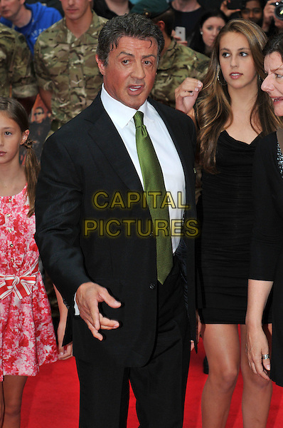 Sylvester Stallone.The 'The Expendables 2' UK film premiere, Empire cinema, Leicester Square, London, England..August 13th, 2012.half length black suit white shirt green tie hand arm mouth open .CAP/BF.©Bob Fidgeon/Capital Pictures.