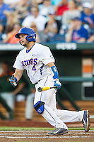 Florida Gators catcher Mike Rivera (4) heads first base against the Miami Hurricanes in the NCAA College World Series on June 13, 2015 at TD Ameritrade Park in Omaha, Nebraska. Florida defeated Miami 15-3. (Andrew Woolley/Four Seam Images)