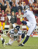 Seattle Seahawks place kicker Steven Hauschka (4) kicks the final field goal in the fourth quarter against the Washington Redskins at FedEx Field in Landover, Maryland on Monday, October 6, 2014.  The Seahawks won the game 27 - 17.<br /> Credit: Ron Sachs / CNP