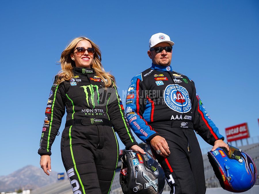 Feb 7, 2018; Pomona, CA, USA; NHRA top fuel driver Brittany Force (left) and funny car driver Robert Hight pose for a portrait during media day at Auto Club Raceway at Pomona. Mandatory Credit: Mark J. Rebilas-USA TODAY Sports