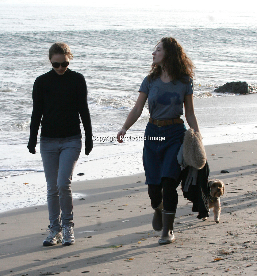 12-3-09.Exclusive.Natalie Portman walking her Dog in Santa Monica California with her friend. Natalie was laughing & talking about the lovely ocean but that it a little to cold out for her and pulled her sleaves down to cover her hands. ...www.AbilityFilms.com.805-427-3519.AbilityFilms@yahoo.com
