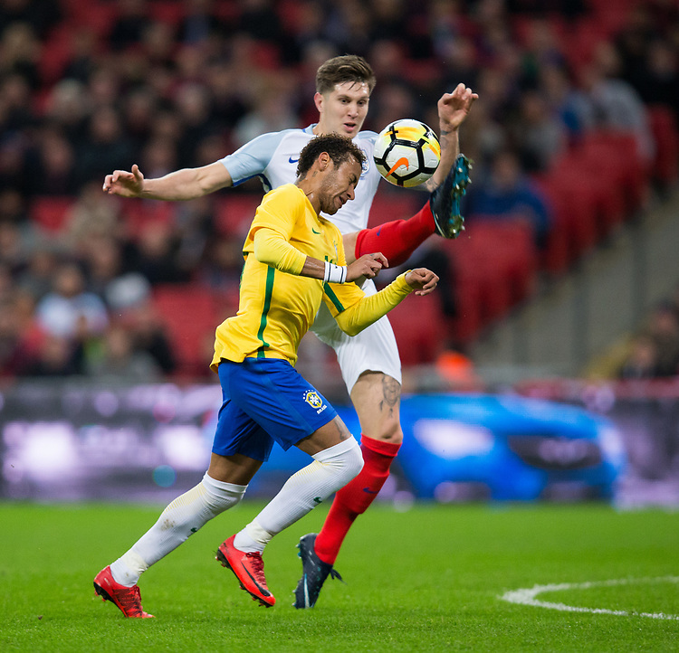 Brazil&rsquo;s Neymar Jr vies for possession with England's John Stones <br /> <br /> Photographer Craig Mercer/CameraSport<br /> <br /> The Bobby Moore Fund International - England v Brazil - Tuesday 14th November 2017 Wembley Stadium - London  <br /> <br /> World Copyright &copy; 2017 CameraSport. All rights reserved. 43 Linden Ave. Countesthorpe. Leicester. England. LE8 5PG - Tel: +44 (0) 116 277 4147 - admin@camerasport.com - www.camerasport.com
