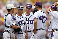 TCU's coach Jim Schlossnage meets with his team on the mound against Florida State in Game 1 of the NCAA Division One Men's College World Series on Saturday June 19th, 2010 at Johnny Rosenblatt Stadium in Omaha, Nebraska.  (Photo by Andrew Woolley / Four Seam Images)