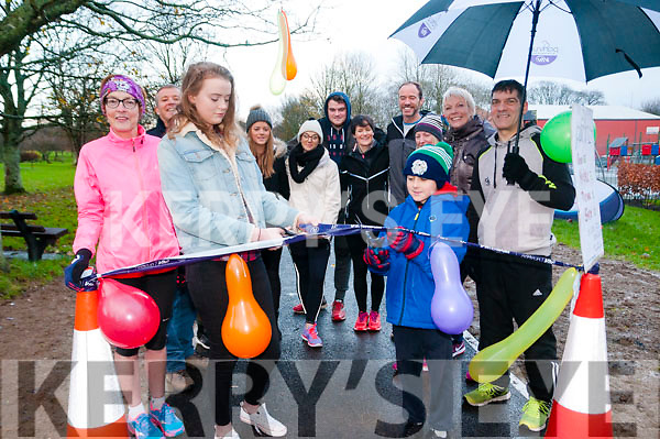 Park Run Opening : Laura Purcell & Jake segal cutting the tape at the official opening  of the new pathway for the park Run made by Listowel Council on Saturday last.