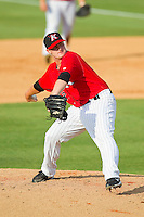 Kannapolis Intimidators relief pitcher David Cales (32) in action against the Greenville Drive at CMC-Northeast Stadium on June 29, 2013 in Kannapolis, North Carolina.  The Intimidators defeated the Drive 9-3 in the completion of the game that began on June 28, 2013.   (Brian Westerholt/Four Seam Images)
