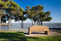 A bench, honoring and remembering a family's mother, offers a view south, along San Francisco Bay at the San Leandro Marina Park.