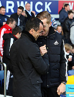 Pictured L-R: Formet team mates, Everton manager Roberto Martinez and Swansea head coach Garry Monk. Sunday 16 February 2014<br />