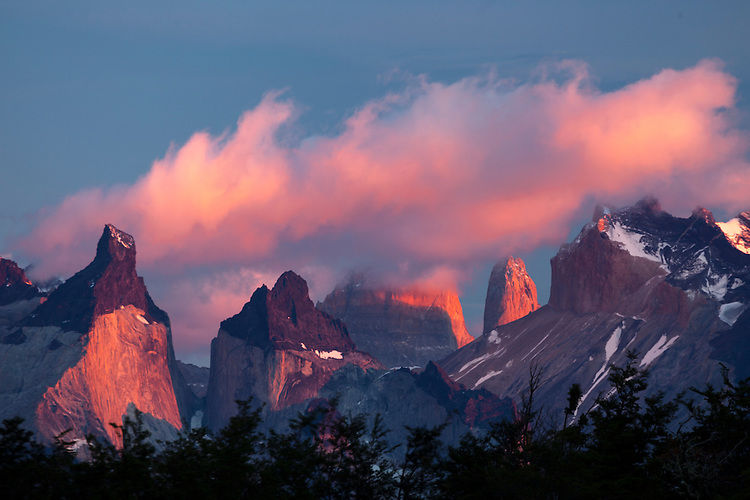 The fiery light of sunrise strikes the dramatic Horns of Paine in Torres del Paine NP, Chile