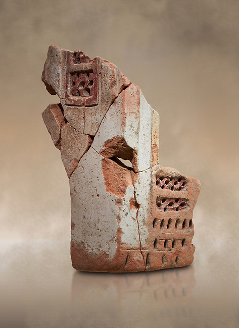 Hittite terra cotta fragmants of a defenive wall tower shaped vessel . Hittite Period, 1600 - 1200 BC.  Hattusa Boğazkale. Çorum Archaeological Museum, Corum, Turkey. Against a warm art bacground.