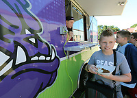 NWA Democrat-Gazette/DAVID GOTTSCHALK Camden Mitchell, a fifth grade student at McNair Middle School, picks up his taco lunch Monday, October 7, 2019, after being served from the Fayetteville Public Schools' Purple Dog Food Truck at the school in Fayetteville. The truck offered an authentic Mexican meal Monday and will visit Holt Middle School on Wednesday.