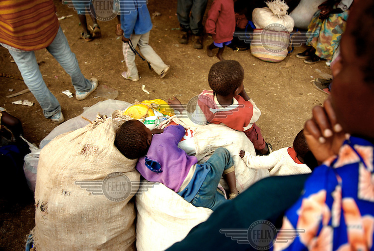 A child sleeps on its family's belongings at an IDP (internally displaced persons) camp in Nakuru.