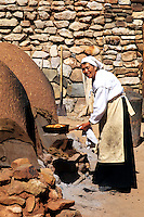 Old fashioned woman baking bread in old style in San Miguel de Allende Mexico.