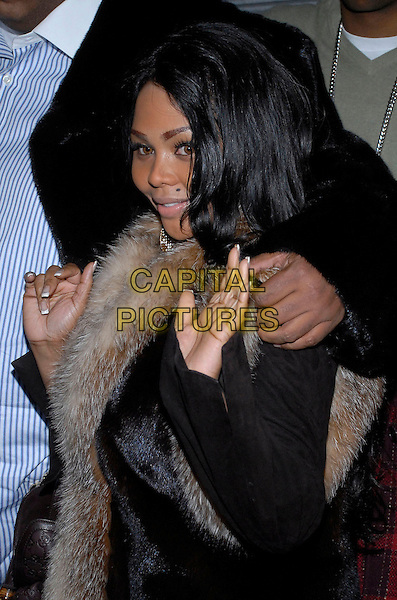 """LIL' KIM.The stars come out to party and celebrate """"The Perfect Holiday""""  at Marquee, New York, New York, USA,.10 December 2007..half length hands waving.CAP/ADM/BL.©Bill Lyons/AdMedia/Capital Pictures. *** Local Caption ***"""