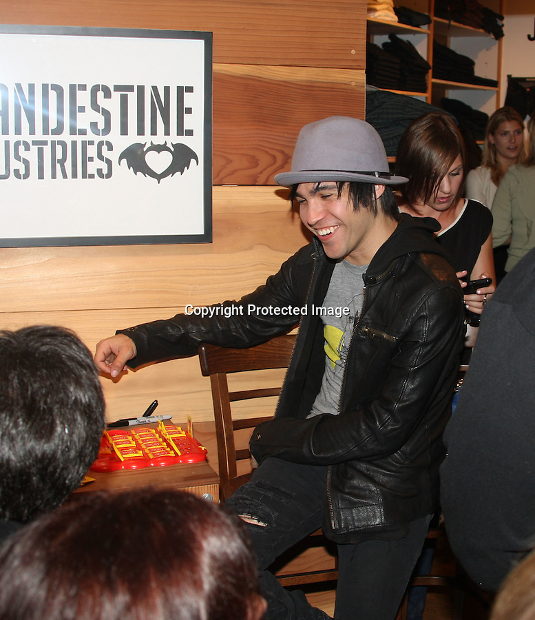 "9-10-09..Pete Wentz was playing the board game ""Guess Who""  at a huge event going on at Fred Segal in west Hollywood. Pete was playing the game with fans who were waiting in line to play with him. Pete played the game for over an hour before Ashlee showed up & played with him. Ashlee won the first game she played & took pictures with fans during breaks. The couple was laughing & joking around while they played the game. Audrina Patridge & Sidney Poitier were also at the event. .....AbilityFilms@yahoo.com.805-427-3519.www.AbilityFilms.com."