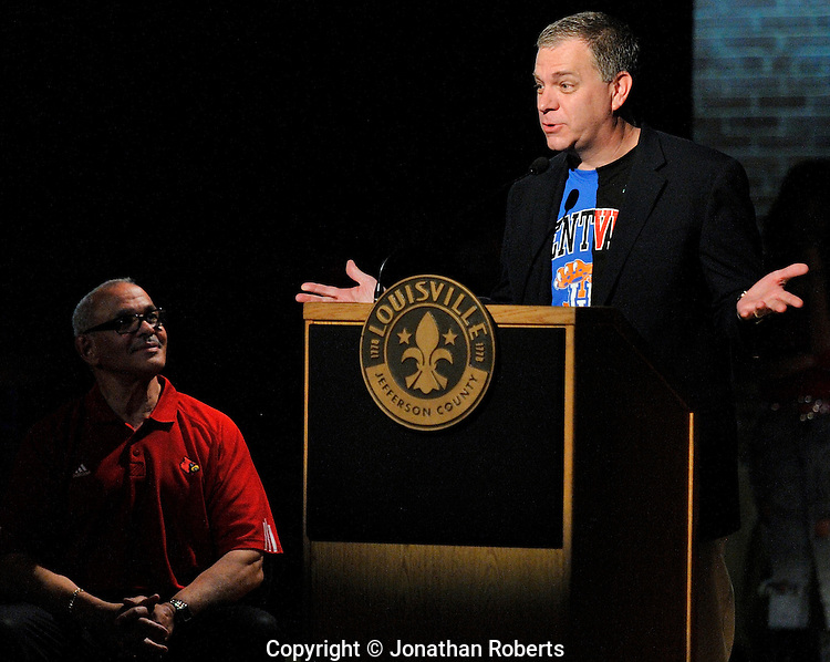 Mike Berry, President and CEO of the Kentucky Derby Festival, right, speaks as Central High School Principal Dr. Dan Withers listens during a press conference for Mayor Greg Fischer's Give A Day week of community service...