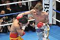 (L-R) Suriyan Sor Rungvisai (THA), Yota Sato (JPN),.MARCH 26, 2012 - Boxing :.Yota Sato of Japan hits Suriyan Sor Rungvisai of Thailand in the seventh round during the WBC super flyweight title bout at Korakuen Hall in Tokyo, Japan. (Photo by Hiroaki Yamaguchi/AFLO)