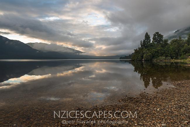 Moody sunrise at Lake Kaniere near Hokitika, West Coast, South Westland, South Island, New Zealand, NZ
