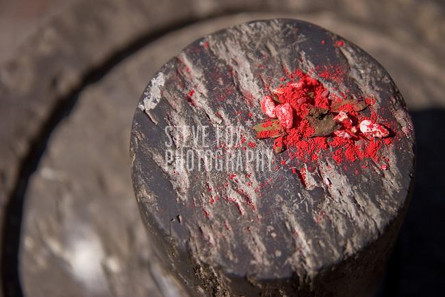 Bindhi powder at Naga Pokhari, Royal Palace, Bhaktapur, Nepal