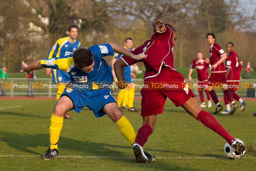 Kezie Ibi of Chelmsford City tries to get behind Rob Rice of Basingstoke Town - Chelmsford City vs Basingstoke Town - Blue Square Conference South Football at Melbourne Park Stadium, Chelmsford - 24/03/12 - MANDATORY CREDIT: Ray Lawrence/TGSPHOTO - Self billing applies where appropriate - 0845 094 6026 - contact@tgsphoto.co.uk - NO UNPAID USE.